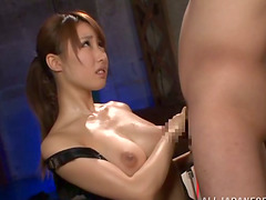 Naughty Japanese cutie is handjobing osme guy