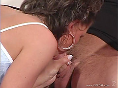 A milf gives a blowjob to a guy and lets him fuck her beefy twat