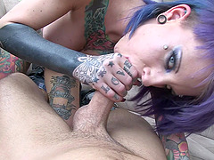 Purple haired punk chick giving blowjob