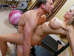 Athletic blonde MILF with big tits gets fucked in the gym