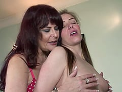 Enticing lesbian scene with a milf being fingered and licked