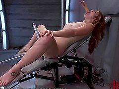 Redhead is enjoying fucking machine