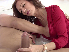 Skinny mature beauty sits her cunt on an uncut cock