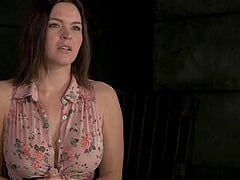 Busty chick in shackles opens her mouth for an erecred penis