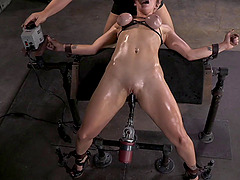 Couple of horny fellows penetrate a tied up redhead chick