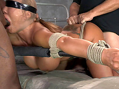 Woman with fake tits wants to feel a randy man's cock during a BDSM game