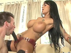 Angelina Valentine the sexy brunette fucks a guy with strap on