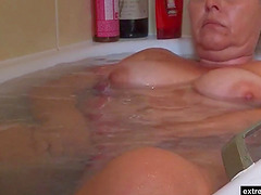 My busty chubby mature unaware of the hidden camera. Enjoy her big naturals