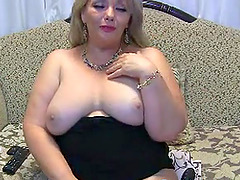Beautiful  Milf Melisa shows her massive jugs for the camera