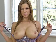 Atractive cougar Carol Goldnerova strips and plays with her boobs