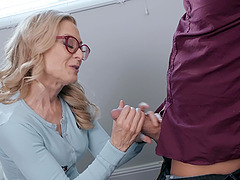 Mature babe with glasses Nina Hartley throats a fat dick and gets cum