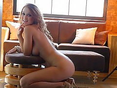Pretty chick Leanna Decker has a photosession in the living room