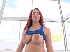 Busty redhead gets down on a hard cock with her mouth