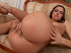 Passionate brunette girl plays with her smooth pussy