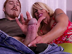 Busty blonde pornstar Gina West takes a hard dick in her hands
