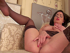 Naughty mature Crystall Anne moans while fingering her pussy