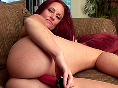 Naughty redhead mature Sandi Lymm loves poking her pussy with a dildo