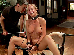 Blonde chick gets fucked with a fucking machine in BDSM vid