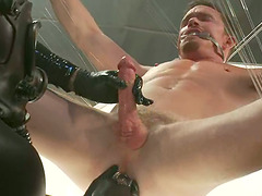Three muscular gays fuck a submissive dude in a basement