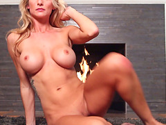 Curvy blond sex diva Jessia Ann in a solo performance